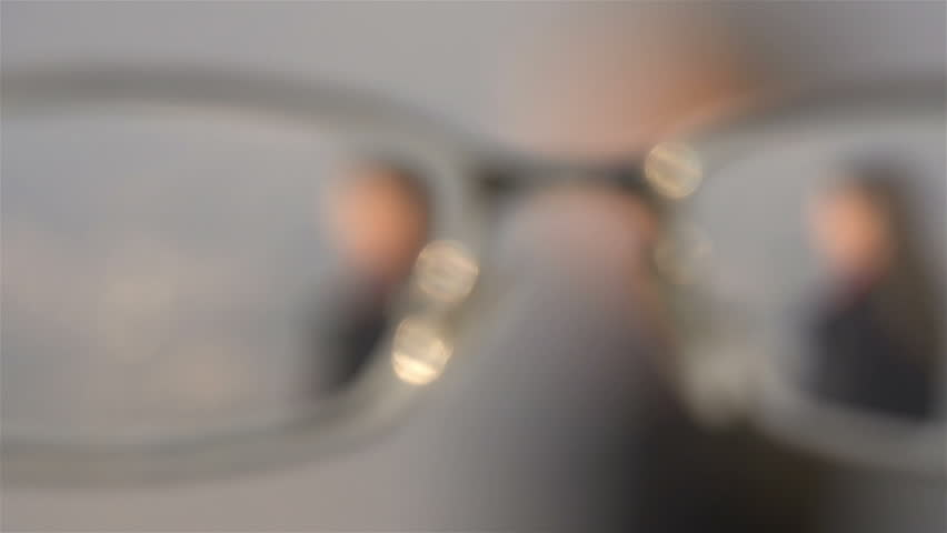 FIRST PERSON VIEW: Putting on glasses | Shutterstock HD Video #4179536