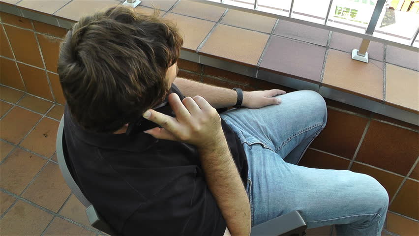 Man Talking Phone in Balcony - HD stock video clip