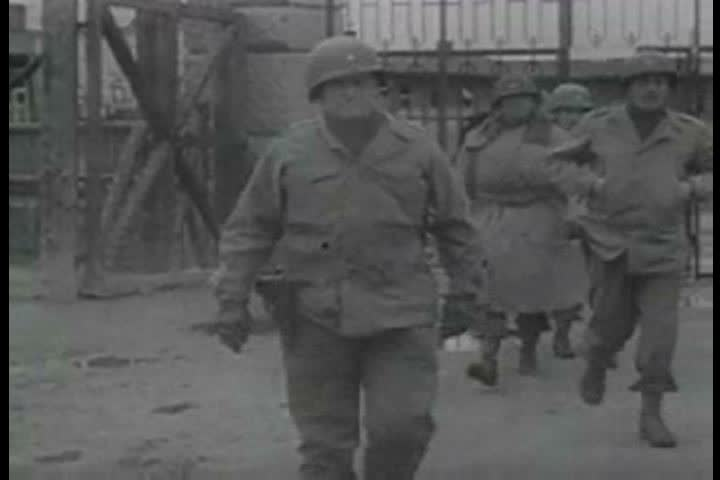 1940s - General Dwight D. Eisenhower visits a recently liberated concentration camp and finds mass graves and piles of dead bodies during the 1940s