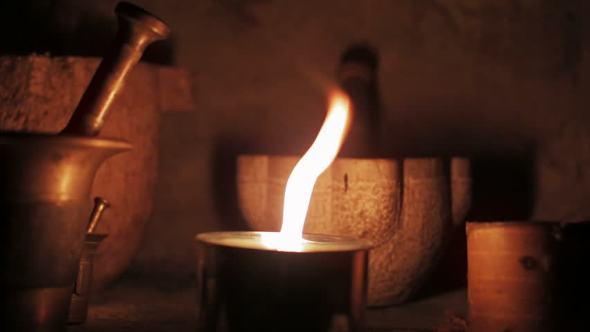 Flame of the candle moving for the wind in a witchery place