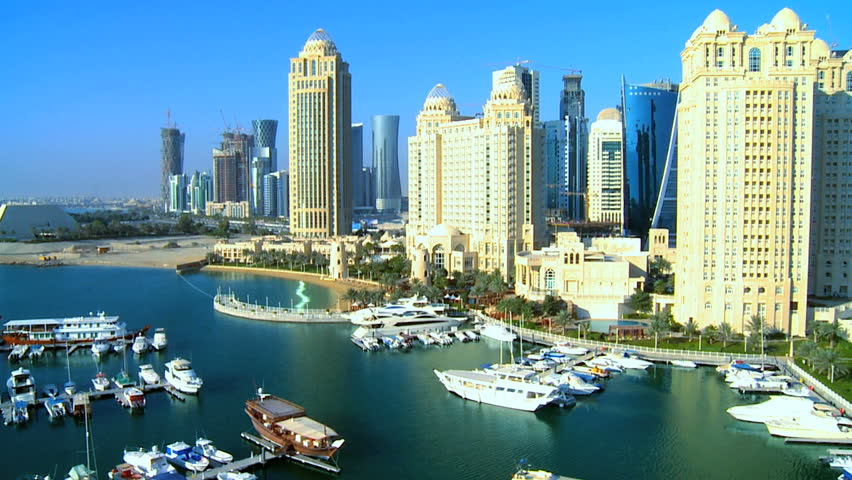 Aerial view Four Seasons Marina Doha luxury boats moored city skyscrapers Doha, Qatar, Persian Gulf - HD stock video clip