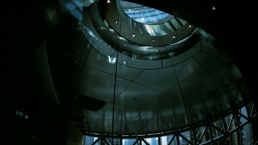Ascending city elevator in modern skyscraper building, Middle East