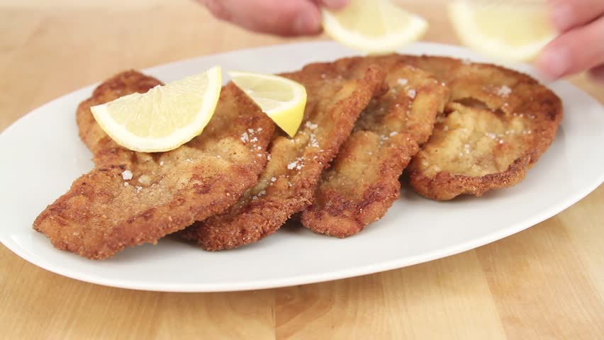 Seasoning Veal Escalope With Salt And Pepper Stock Footage Video ...