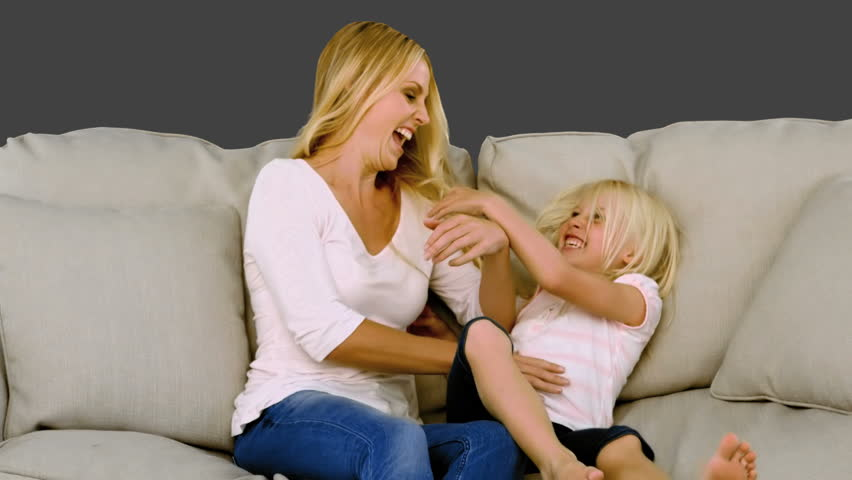 Mother having fun with her daughter in slow motion on grey background - HD stock video clip