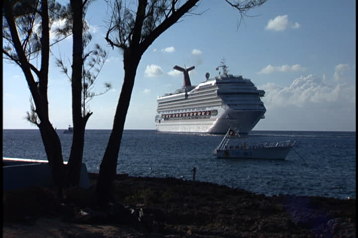 GRAND CAYMAN, CAYMAN ISLANDS - DECEMBER 11, 2003: Cruise ship anchored off the coast of the Grand Cayman Island.
