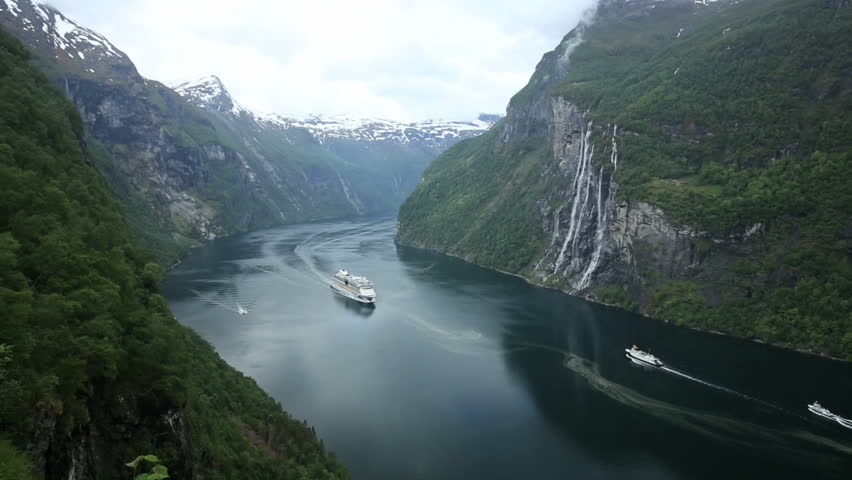 Cruise ship and ferry passes in fjord of Norway