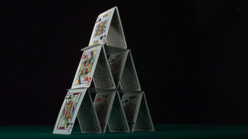 Pyramid house of playing cards falling down shooting with high speed camera, phantom flex.