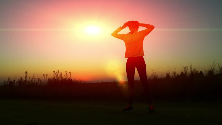 woman running at sunrise in Africa - HD stock video clip