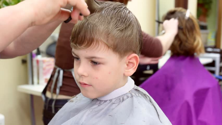 Child gets a haircut in tonsorial  - HD stock footage clip