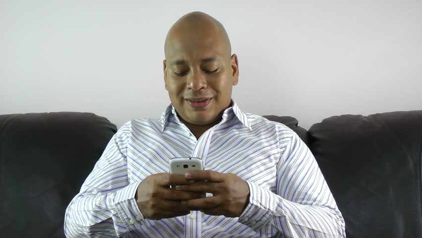 african american businessman using smart phone emailing at home - HD stock footage clip