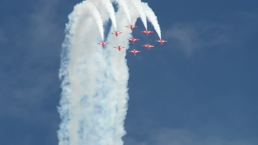 VOLKEL, NETHERLANDS - June 14 2013: The RAF Red Arrows in nosedive formation during an airshow at Volkel, Netherlands, June 14, 2013