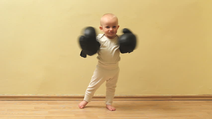 Funny little babythreaten with his box gloves
