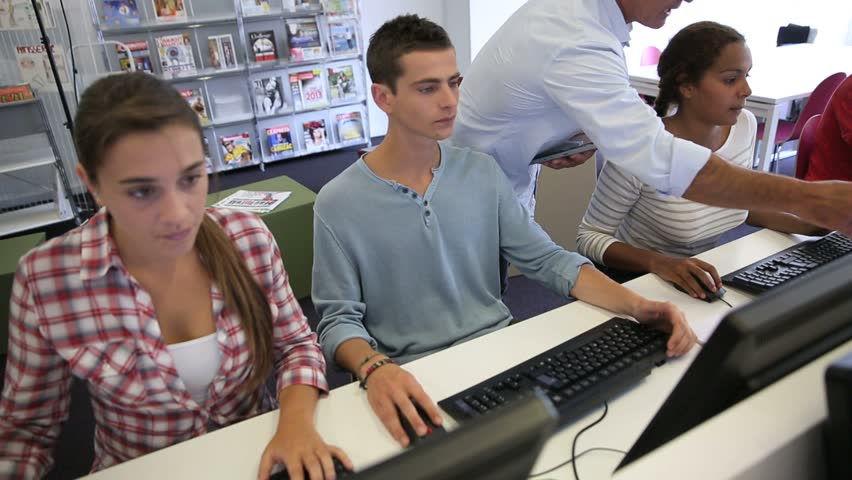 Students in computers' laboratory with teacher
