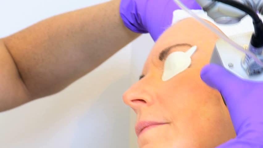 Senior Caucasian female receiving painless facial cosmetic surgery modern clinic full frame - HD stock video clip