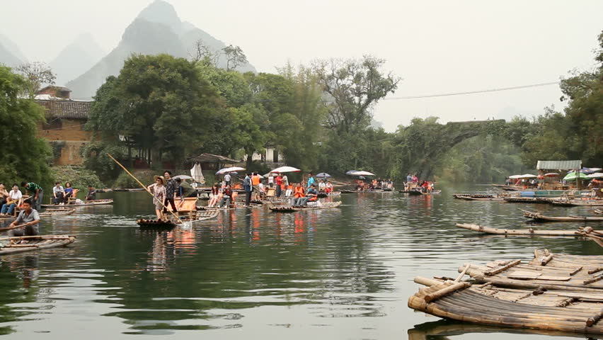 YANGSHUO, GUANGXI, CHINA - OCTOBER 21: Bamboo raft on Yulong river with ancient