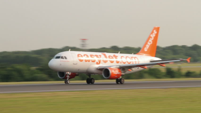MANCHESTER, LANCASHIRE/ENGLAND - JULY 05: Easyjet Airbus A319 takes off from Manchester Airport on July 05, 2013 in Manchester. Easyjet was launched by Cypriot businessman Stelios Haji-loannou in 1995