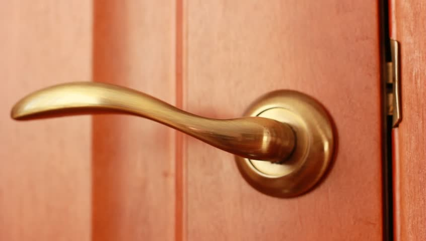 Men's hand opens and closes the door
