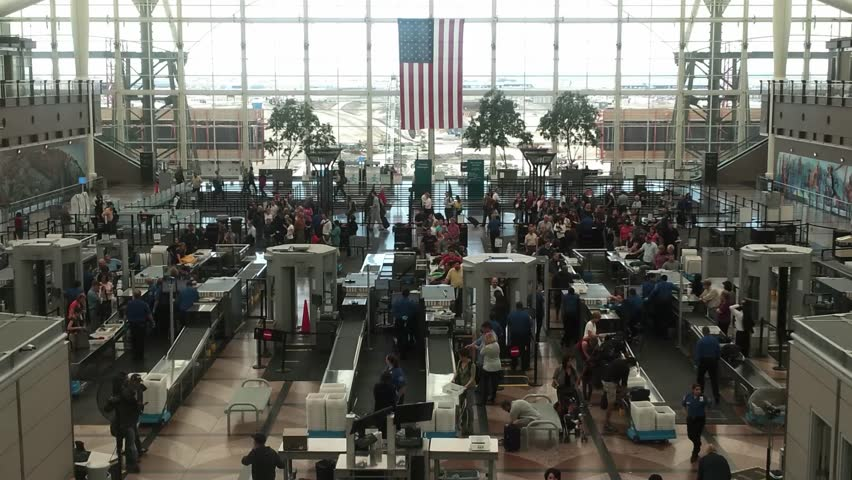 Denver, Colorado - May, 2013 - Medium shot of Denver Airport centered on the people going through security.