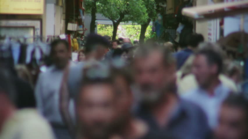 Crowd Walking through Narrow Market Street - HD stock footage clip