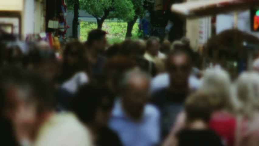 Large Anonymous Crowd Walking through Narrow Market Street Slow Motion - HD stock footage clip