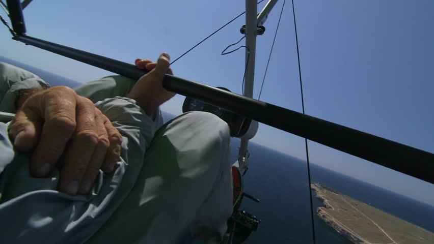 Flying over Black sea coast on motorized hang glider