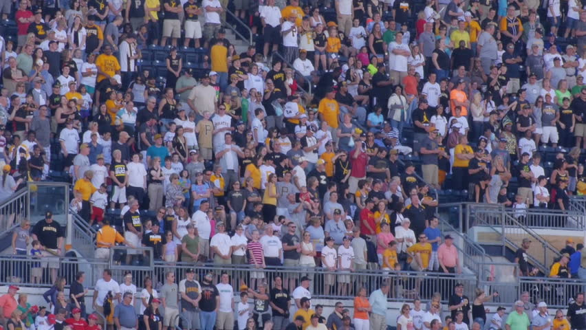 PITTSBURGH, PA, Circa August, 2013 - Fans sing Take Me Out to the Ball Game at a