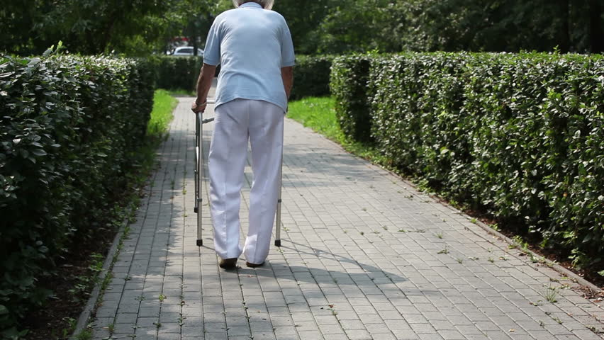 Back-view of a senior man taking first steps after bed regime | Shutterstock HD Video #4388282