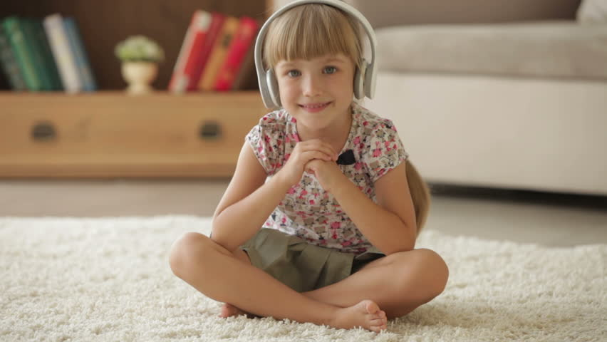 Beautiful little girl in headphones sitting on floor and for Kid chat rooms 12 14