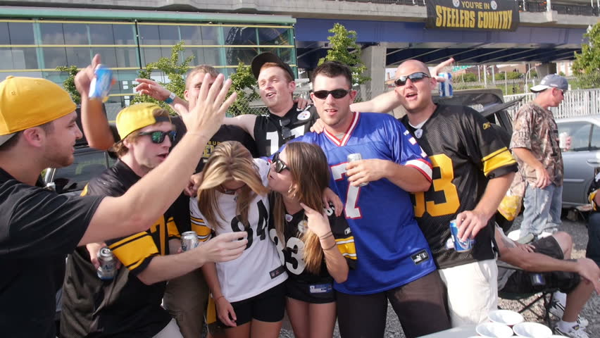 PITTSBURGH, PA, Circa August, 2013 - Sports fans tailgate in a parking lot near