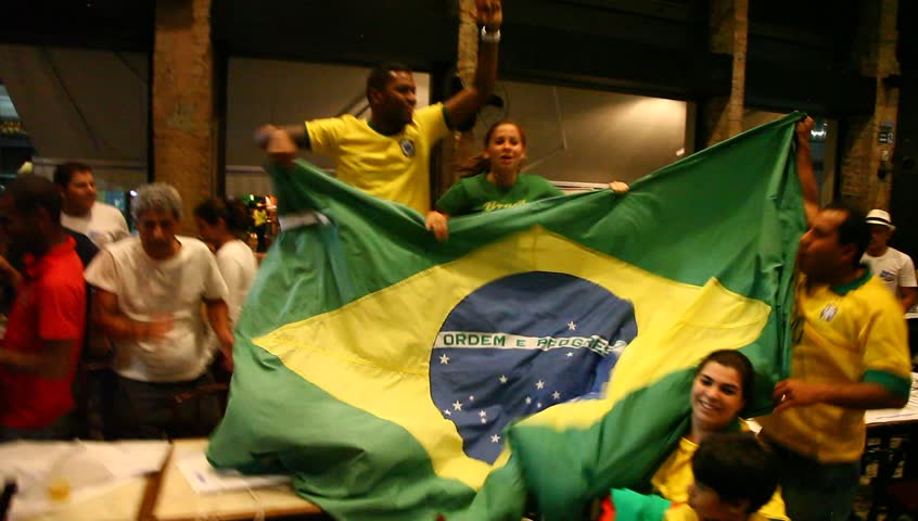 RIO DE JANEIRO, BRAZIL - JUNE 30: Cariocas (residents of Rio) in pub cheer their team as Brazil wins the Confederations Cup against Spain 3:0. Rio de Janeiro, Brazil, June 30, 2013.
