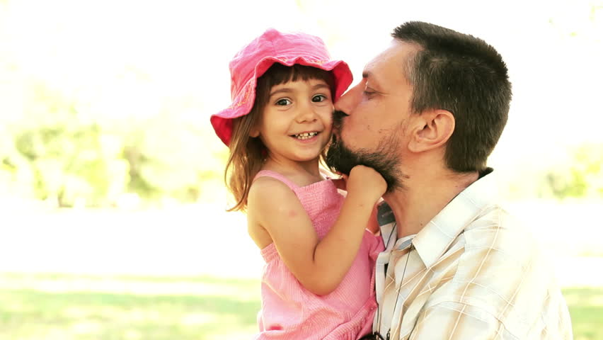 Father holding daughter have fun. Outdoor summer daylight medium shot portrait.  - HD stock footage clip