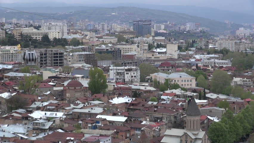 Live Videos Cars Tbilisi Georgia: 18 APRIL 2013: A Cable Car Moves In