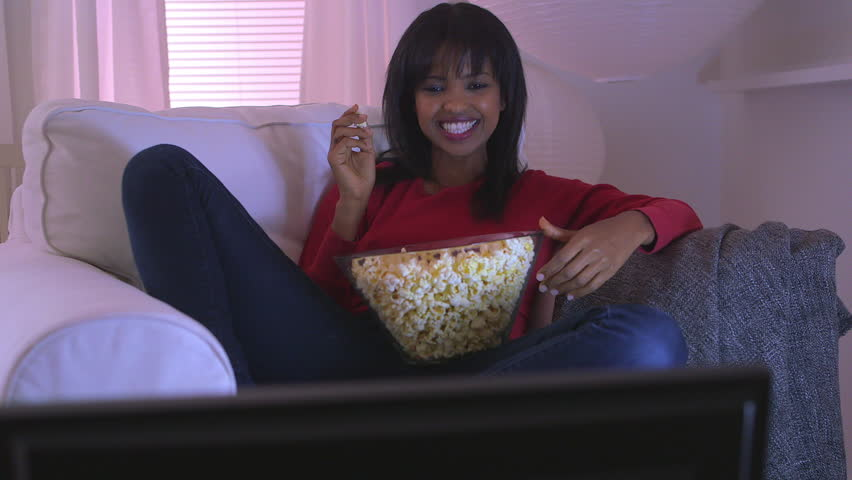 black girl watching funny movie at home stock footage