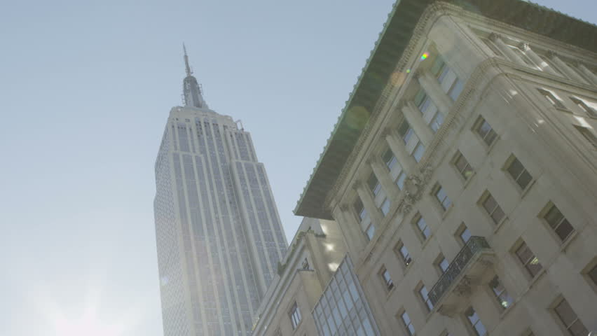 Low angle view of the Empire State Building and the surrounding buildings on a bright sunny day in New York City. #4435271