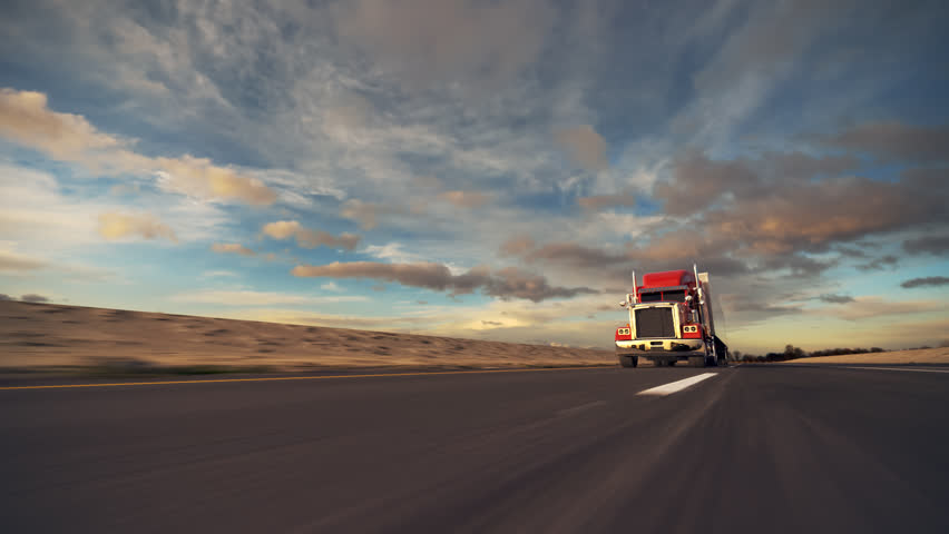 18 Wheel Truck on the road with sunset in the background. Large delivery truck is moving towards setting sun. | Shutterstock HD Video #4462757
