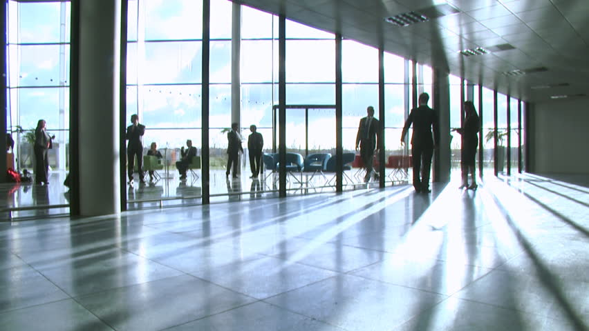 Business group in a large contemporary office building. High quality HD video footage
