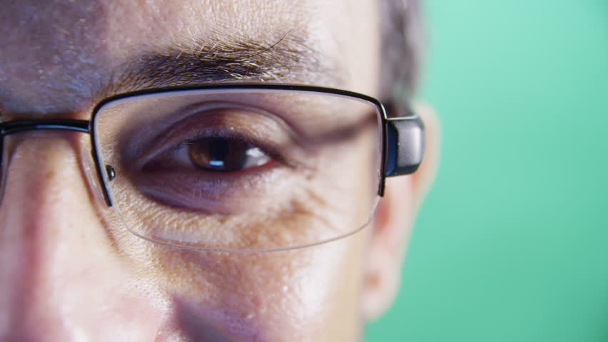 Close-up of mans eyes and glasses.