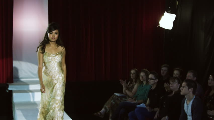 Spectators applauding models on catwalk runway at a fashion show - HD stock footage clip