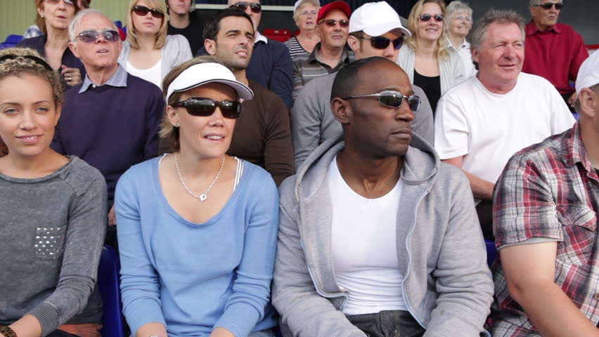 Enthusiastic crowd of tennis sports fan spectators. People young and old cheering and smiling. - HD stock video clip