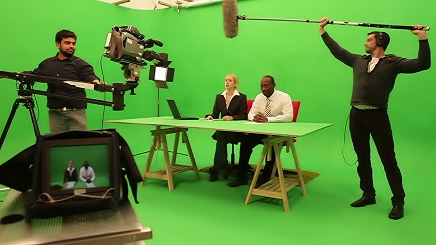 Television media news goes live. A greenscreen studio set prepares for broadcast transmission.