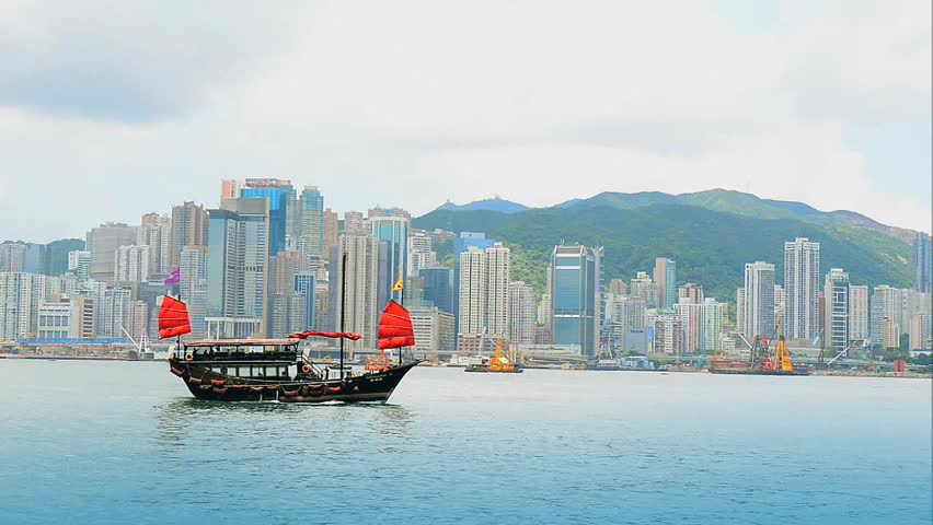 Junk boat with tourists in Hong Kong Victoria Harbour - HD stock video clip