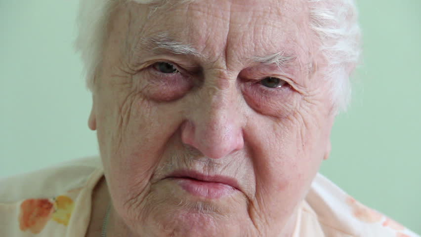 Sad face of an 85 years old woman. - HD stock video clip