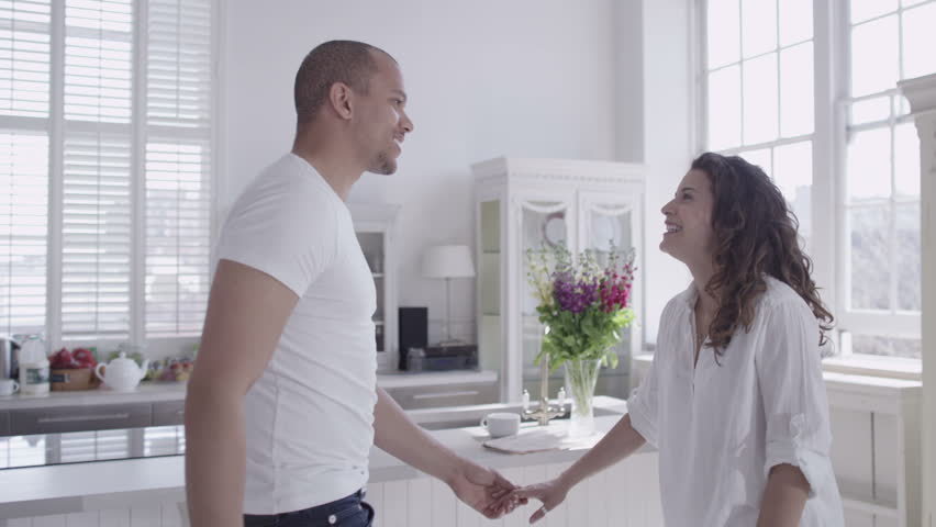 Happy and attractive young mixed race couple viewing a beautiful modern property with a view to making it their home. In slow motion. #4531841