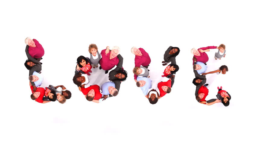 """Group of various people coming together to spell the word """"Love"""". Shot in large white studio. High quality HD video footage."""