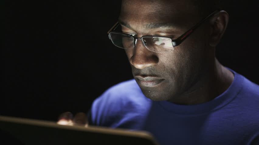Black man reading consider