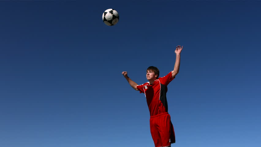 Soccer player heads ball, slow motion - HD stock footage clip