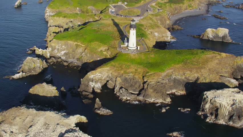 Aerial view of Yaquina Head Lighthouse, Newport, Oregon - HD stock footage clip