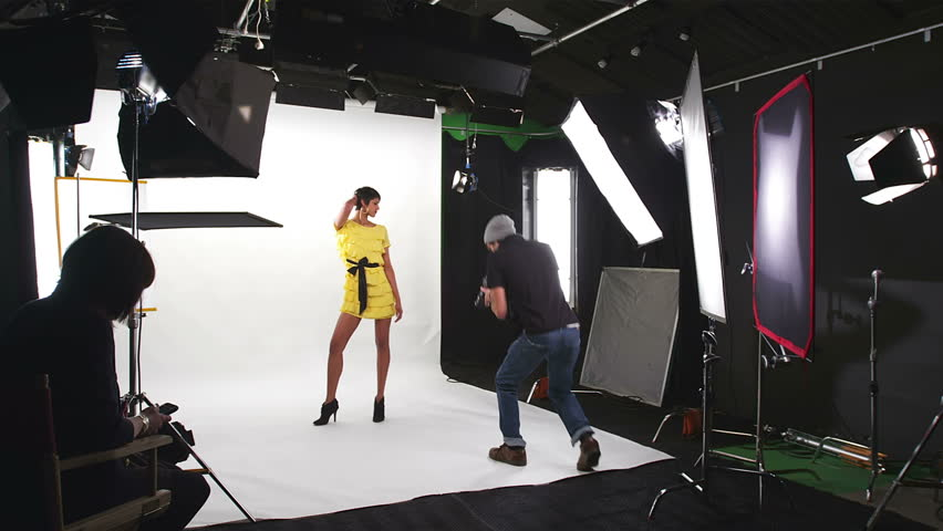 Photo shoot on white inside a studio. Wide dolly shot | Shutterstock HD Video #4587929