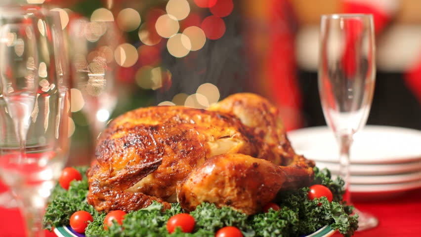 Christmas table setting with turkey on platter