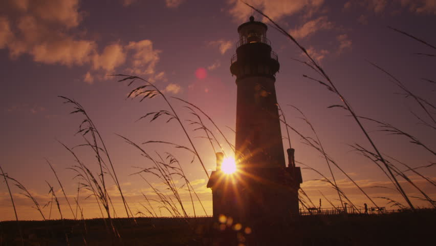 Yaquina Head Lighthouse at sunset - HD stock video clip